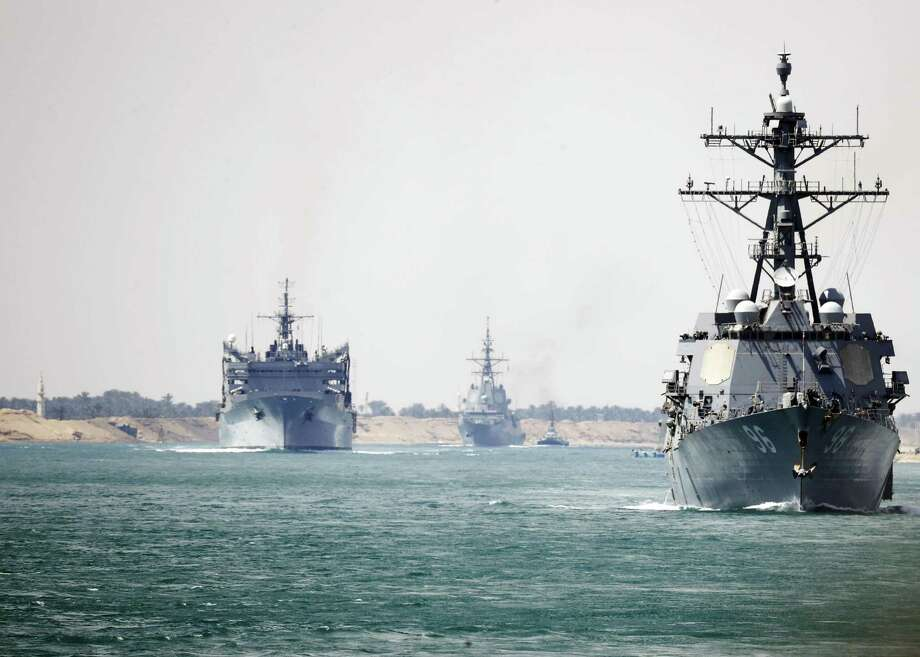 The aircraft carrier Abraham Lincoln and support vessels transit the Suez Canal on May 9, en route to the Persian Gulf. Reports said four vessels were recently attacked at the mouth of the Persian Gulf. President Trump seems to be goading Iran into war. Photo: DARION CHANELLE TRIPLETT /U.S. NAVY /NYT / DARION CHANELLE TRIPLETT/U.S. NAVY