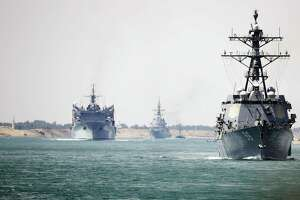 The aircraft carrier Abraham Lincoln and support vessels transit the Suez Canal on May 9, en route to the Persian Gulf. Reports said four vessels were recently attacked at the mouth of the Persian Gulf. President Trump seems to be goading Iran into war.