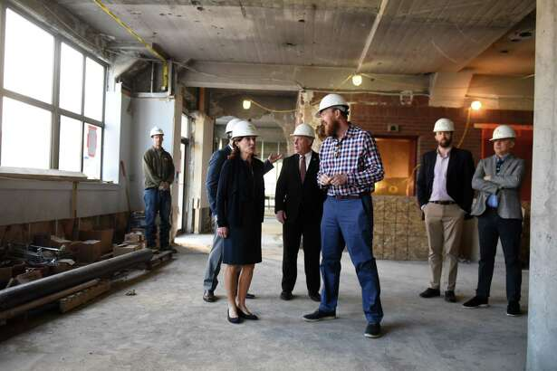 Lt. Gov. Kathy Hochul is given a tour of the former Times Union building by Jeff Buell, principal of Redburn Development Partners, center right, on Tuesday, May 21, 2019, in Albany, N.Y. Redburn is converting property, named The Nick, into a mixed use apartment space. (Will Waldron/Times Union)