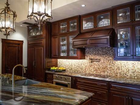 The original plan for the kitchen was just to put in new kitchen countertops, but it became a whole redo with 1-foot bump out to accommodate a new island.