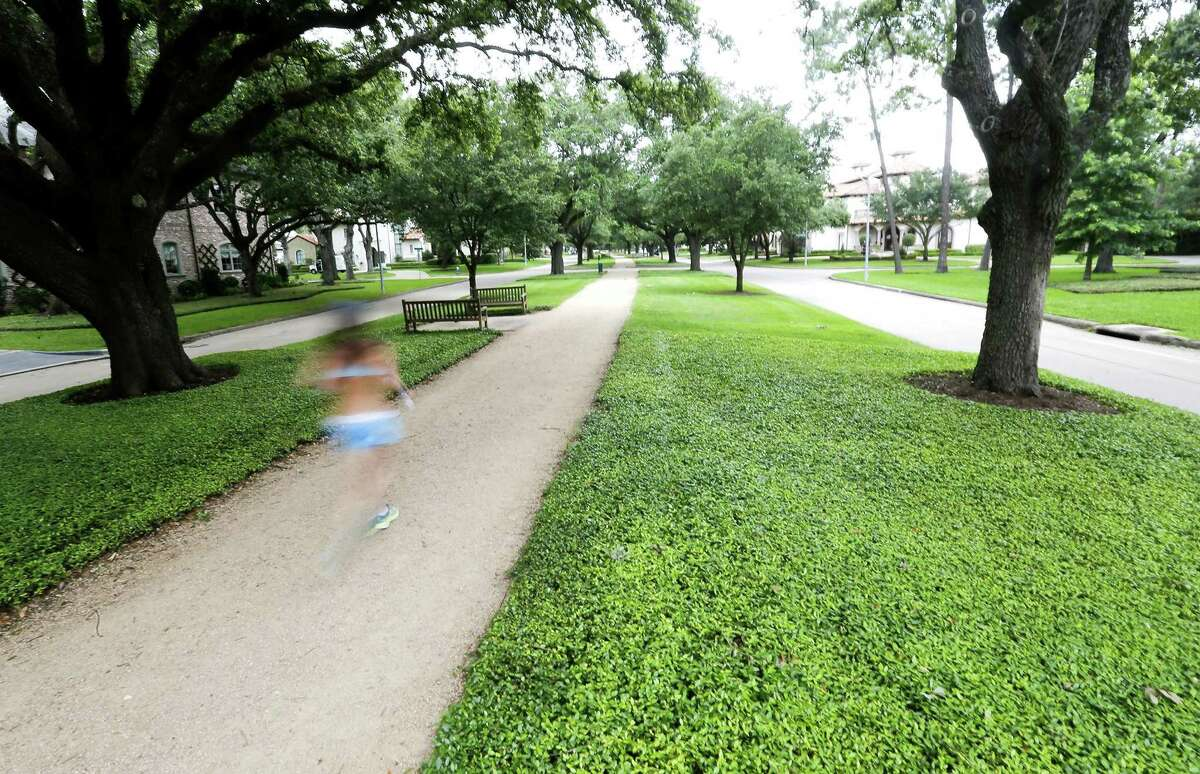 A runner on a path on Tanglewood Blvd,. in the Tanglewood neighborhood on Tuesday, May 21, 2019 in Houston. The Tanglewood residents are suing to keep a high-rise development out of their neighborhood.