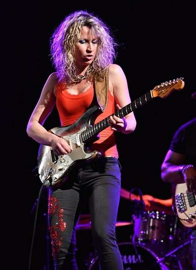 "Serbian born blues guitarist Ana Popovic plays a solo on her Fender Stratocaster guitar in front of a packed house of fans at the Infinity Hall in Hartford on April 18. Ana is on tour promoting her new album ""Like It on Top"", which was produced by Keb Mo. To learn more about this extraordinary guitarist, visit www.anapopvic.com Photo: John Atashian / Contributed Photo /"