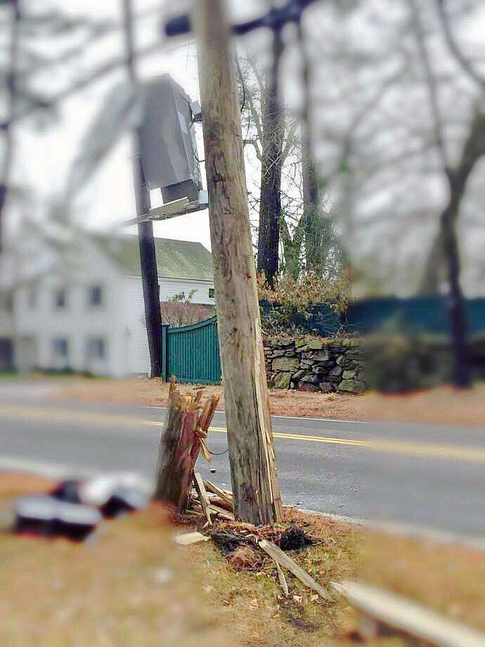 A crash damaged the utility pole on Route 77 in Guilford, Conn., pictured here. Edits to the photo were made by police. Photo: Contributed Photo / Guilford Police Department