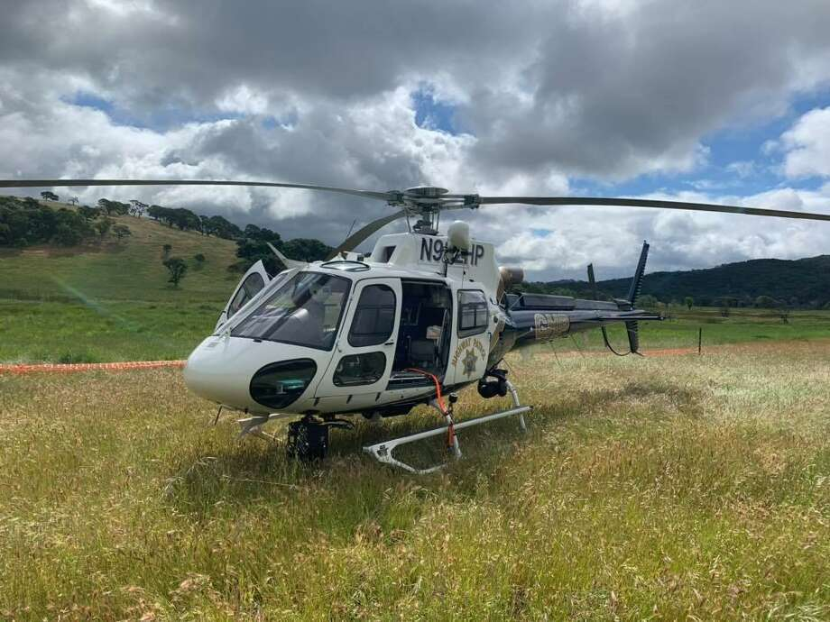 A CHP helicopter was used to hoist a woman to safety after her car plunged 450 feet down a cliff Tuesday in Napa County. Photo: California Highway Patrol