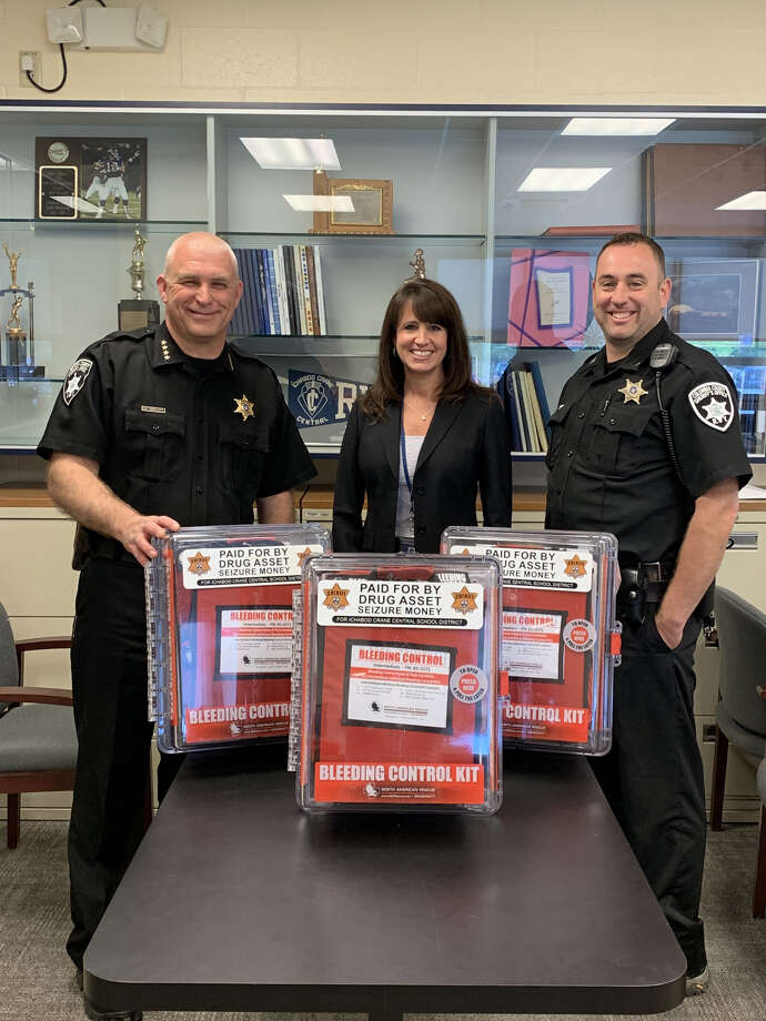 From left, Sheriff David Bartlett, Acting Superintendent Suzanne Guntlow and School Resource Deputy Toby VanAlstyne. Photo: Columbia County Sheriff's Office