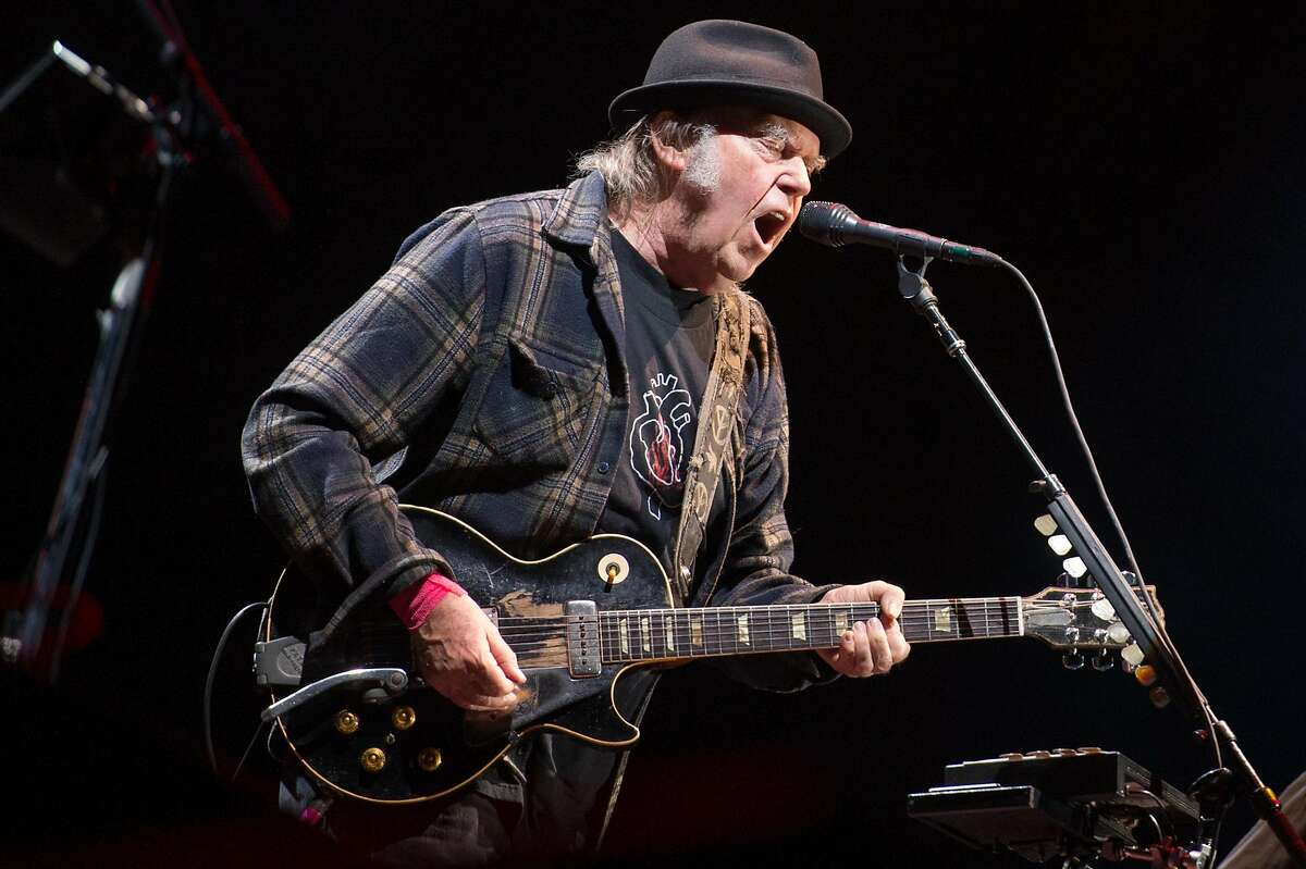 Neil Young performs onstage headlining the mainstage at The Plains of Abraham in The Battlefields Park during day 2 of the 51st Festival d'ete de Quebec (FEQ) on July 6, 2018 in Quebec City, Canada.
