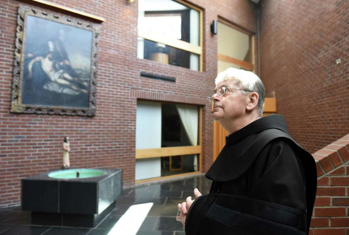 Brother Ed Coughlin stands in the inner lobby at the Siena friary on Wednesday, April 3, 2019 in Loudonville, NY. (Phoebe Sheehan/Times Union)
