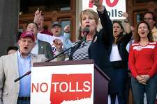 State Rep. Laura Devlin addresses the crowd of anti-toll protesters in front of the Capitol in Hartford in May.