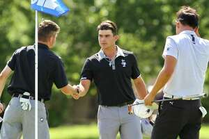 Hunter Bott of Montgomery, center, shakes hands after finishing the final round of the Class 5A UIL State Golf Championships at White Wing Golf Club, Tuesday, May 21, 2019, in Georgetown.