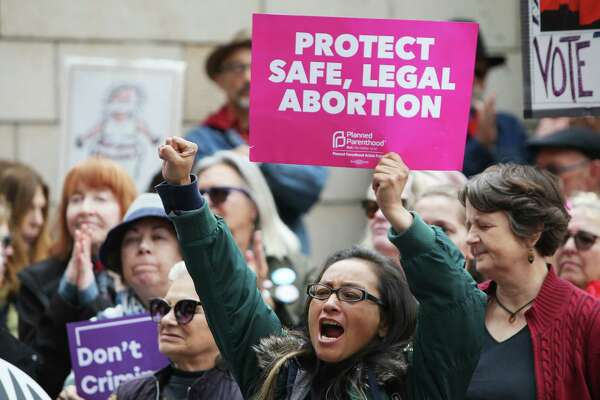 Several hundred people gathered outside of City Hall, Tuesday, as part of a national day of action protesting the strict abortion laws that have been making their way through the legislatures of various states, May 20, 2019. Speakers at the event, organized by NARAL Pro-Choice Washington, included Seattle city council members Lorena Gonzalez, Teresa Mosqueda and Kshama Sawant, Mayor Jenny Durkan and state Attorney General Bob Ferguson.