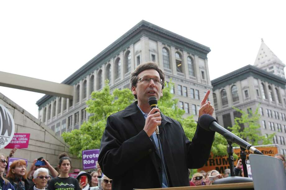 Washington State Attorney General Bob Ferguson speaks as several hundred people gathered outside of City Hall, Tuesday, as part of a national day of action protesting the strict abortion laws that have been making their way through the legislatures of various states, May 20, 2019.  Photo: Genna Martin, SEATTLEPI / GENNA MARTIN