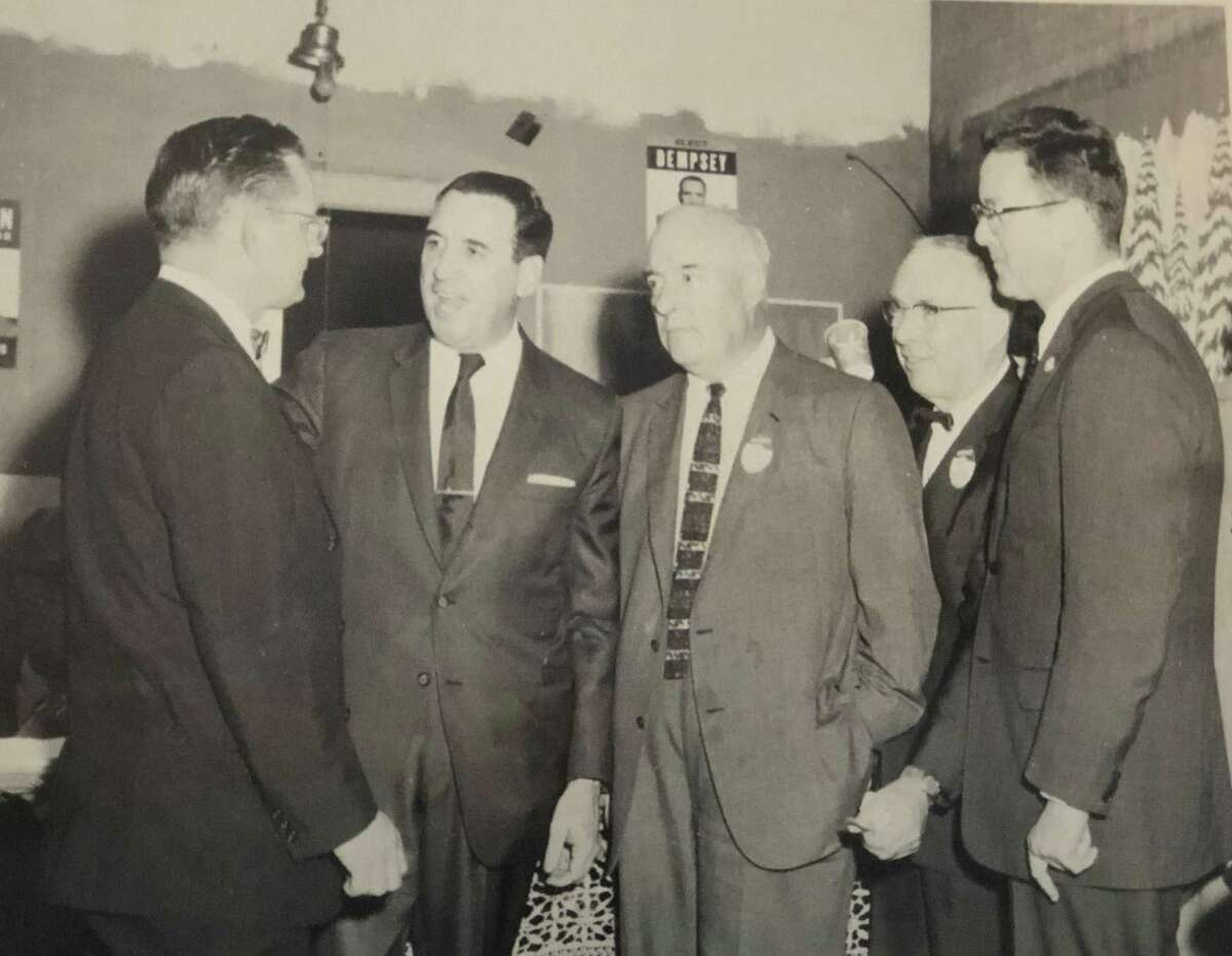 This picture captures a moment on April 15, 1960, at the New Milford headquarters for state election. Shown are, from left to right, Truman T. Richmond, chairman of the Democratic committee, the Honorable John N. Dempsey, governor, Judge Harry B. Bradbury, First Selectman E. Paul Martin and Donald Irving, aide to the governor. If you have a