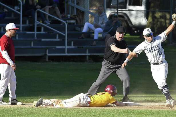 Staples Andrew Moy (15) tags out St. Joseph Aaron Kirby (2) at third base in a FCIAC Semi-final baseball game at Cubeta Stadium on Tuesday, May 21, 2019 in Stamford, Connecticut. Staples defeated St. Joseph 4-2.