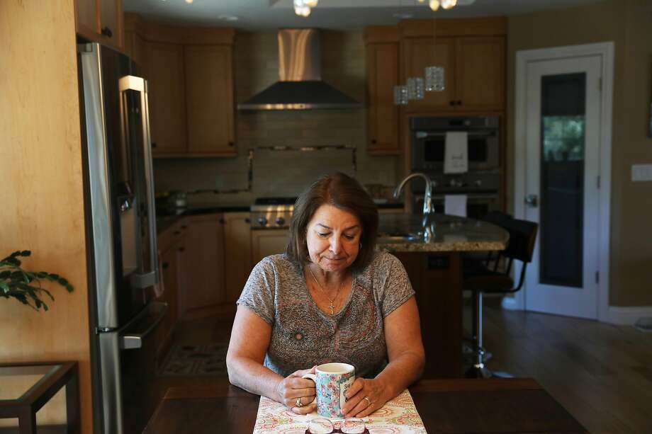 Susan Choate-Brye sits alone in her Clayton kitchen on Jeffrey's birthday last month. Photo: Lea Suzuki / The Chronicle