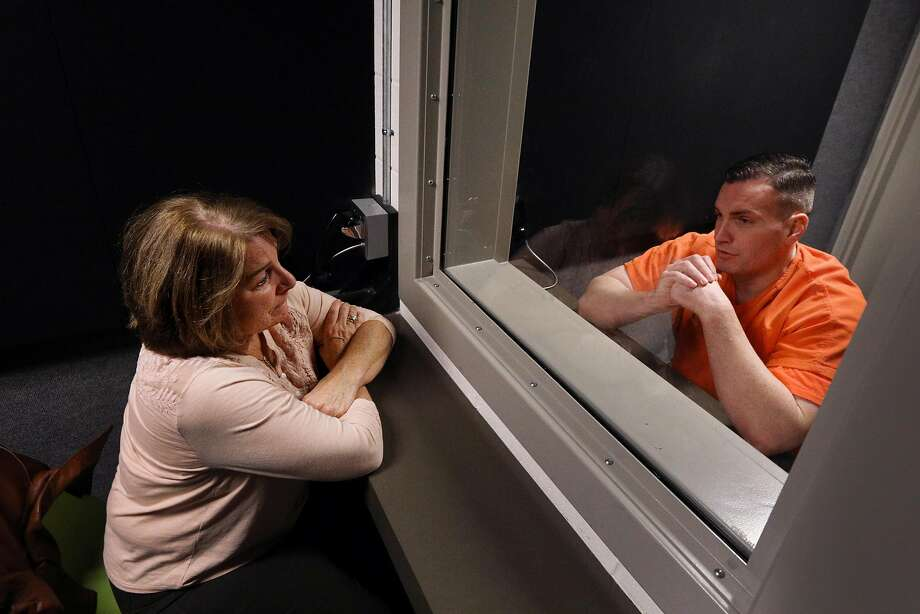 Susan Choate-Brye (l to r) talks with Jeffrey Choate during a visit at the Maple Street Correctional Center  on Sunday, February 10, 2019 in Redwood City, Calif. Photo: Lea Suzuki / The Chronicle