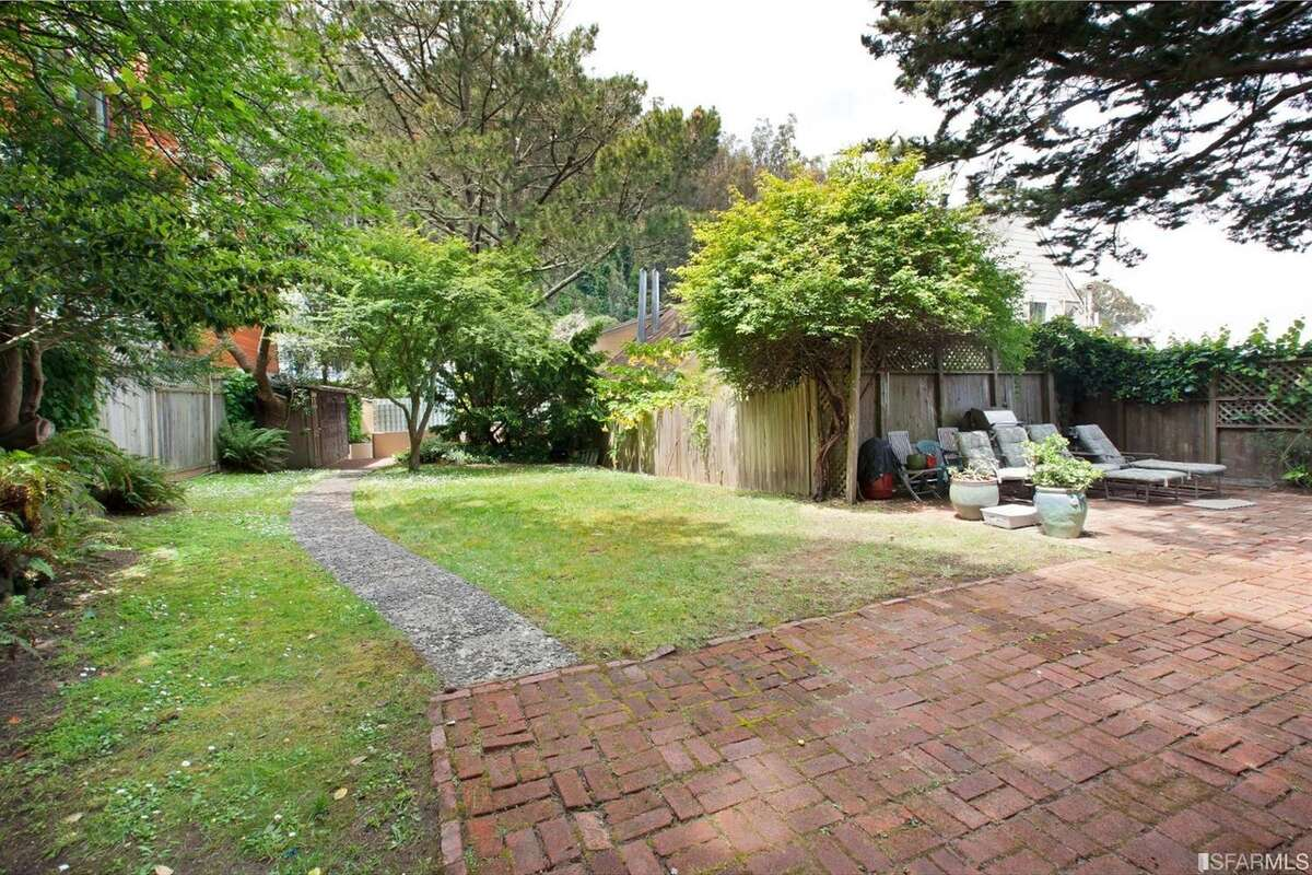 The property has over 10,000 square feet and is set amongst mature trees.