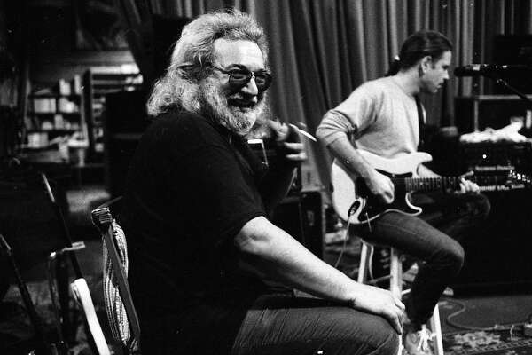 Grateful Dead members (L to r) Jerry Garcia and Bob Weir rehearse, with John Fogerty May 25, 1989 as San Francisco musicians would play a series of concert to benefit AIDS,