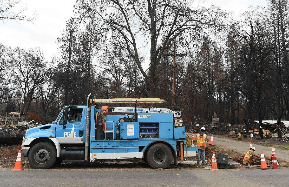 (FILES) In this file photo taken on February 1, 2019 PG&E crews work to restore utility services in Paradise, California. - The fire that destroyed the small town of Paradise, northern California, last November, killing 85 people and devastating more than 60,000 hectares of vegetation, was caused by power lines owned by the energy supplier PG&E, according to the findings of an investigation conducted by the California Department of Forestry and Fire Protection, the agency said in a news release on May 15, 2019. (Photo by Josh Edelson / AFP)JOSH EDELSON/AFP/Getty Images