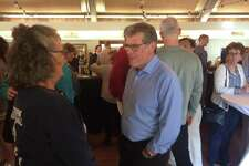 Women's basketball coach Geno Auriemma speaks with a fan during the UConn Coaches Road Show at Latitdue 41 in Mystic on Tuesday night.