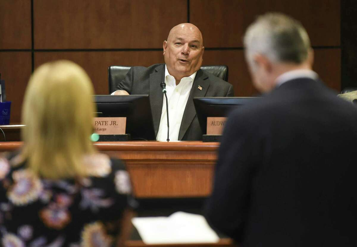 From left to right, Laura Childress, the president of Mardi Gras of Southeast Texas, listens to Councilman W.L. Pate Jr. speak as Event Facility Director with Beaumont Lenny Cabellero stands next to her during the the Beaumont's City Council meeting on Tuesday. Photo taken on Tuesday, 05/21/19. Ryan Welch/The Enterprise