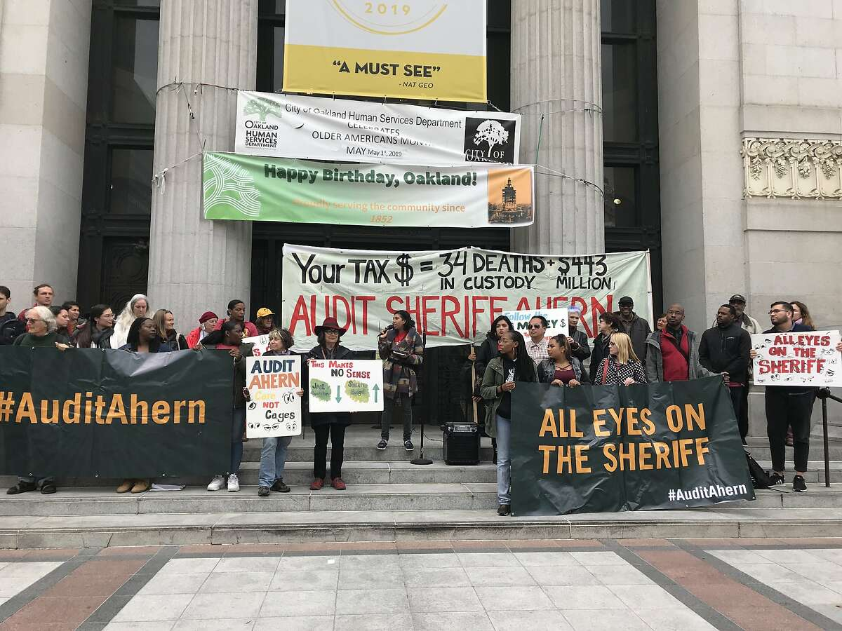 A group of people rally outside Oakland City Hall calling for an independent audit of the Alameda County Sheriff's Office. The City Council approved a resolution calling for the audit as pressure mounts on the department.
