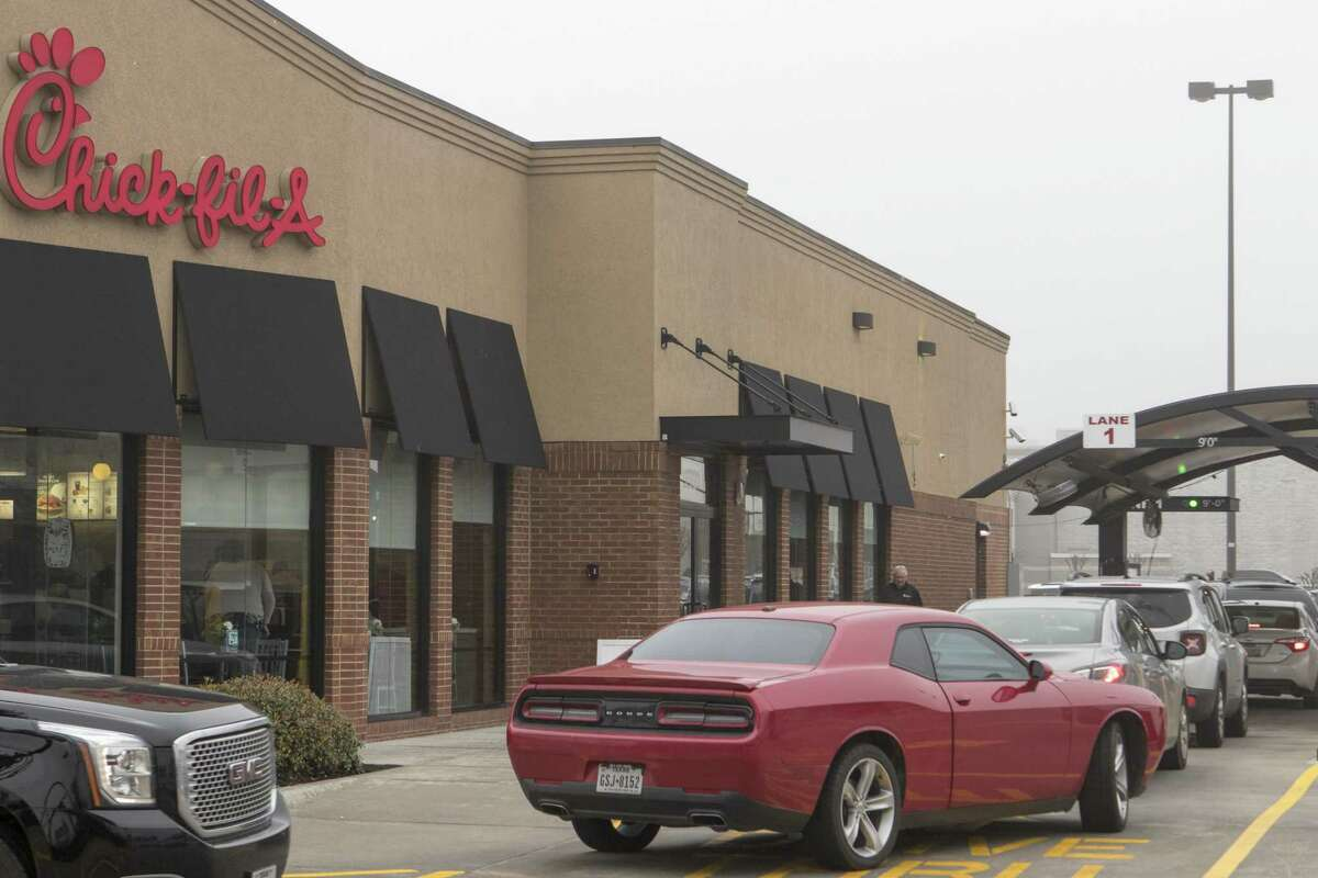Cars fill the Chick-fil-A drive-through lanes Friday, Jan. 18, 2018 at 1321 W. Davis St. in Conroe.
