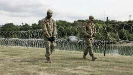 (FILES) In this file photo taken on November 17, 2018, soldiers from the Kentucky-based 19th Engineer Battalion work in a public park in Laredo, Texas, installing barbed and concertina-wire. - A US federal court is set on Friday, May 17, 2019 to hear the first of many challenges to US President Donald Trump's declaration of an emergency to pay for construction of a wall along the southern border with Mexico. The two complaints filed in Oakland, California challenge Trump's February declaration of a national emergency in order to obtain money for the wall, saying the constitution prohibits the move. (Photo by Thomas WATKINS / AFP)THOMAS WATKINS/AFP/Getty Images