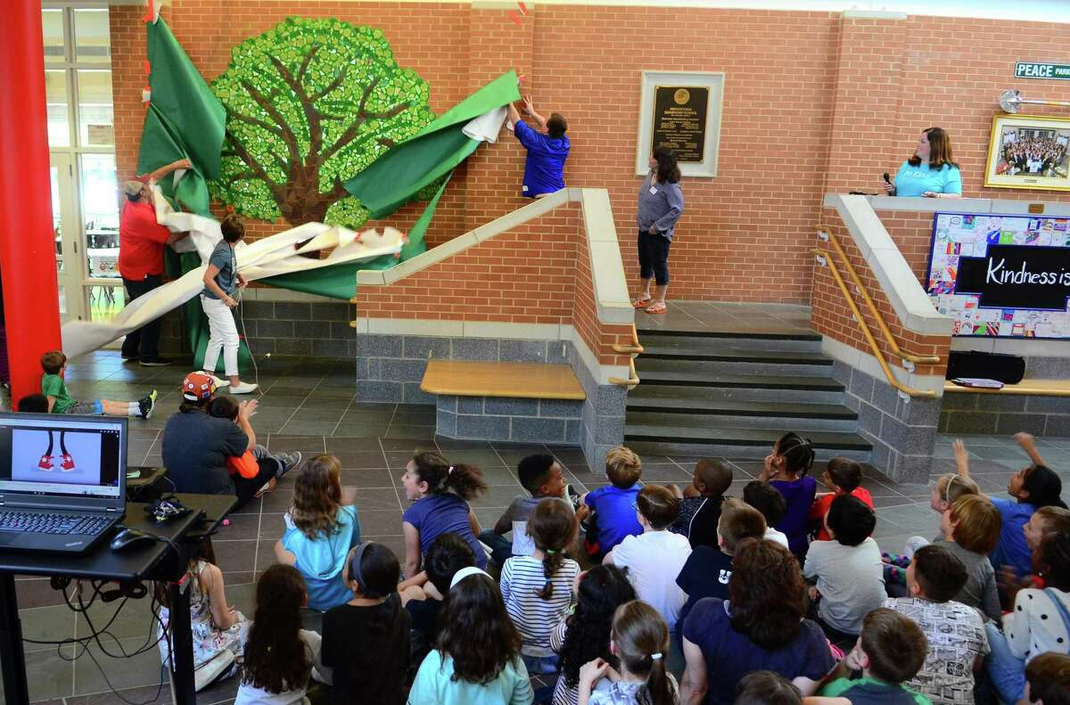 """A Ben's Bells Kindness Tree mural created in conjunction with Frenchtown Elementary School's Kindness Club was unveiled at the school in Trumbull, Conn., on Tuesday May 21, 2019. Ben's Bells """"be kind"""" murals are a series of kindness-themed mosaic murals created by local artists, students, and community members."""