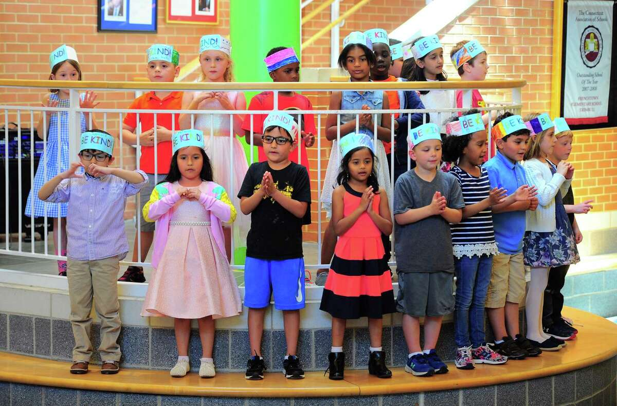 """Frenchtown Elementary School first graders sing a musical selection before the unveiling of a Ben's Bells Kindness Tree mural, which was created in conjunction with the school's Kindness Club in Trumbull, Conn., on Tuesday May 21, 2019. Ben's Bells """"be kind"""" murals are a series of kindness-themed mosaic murals created by local artists, students, and community members."""