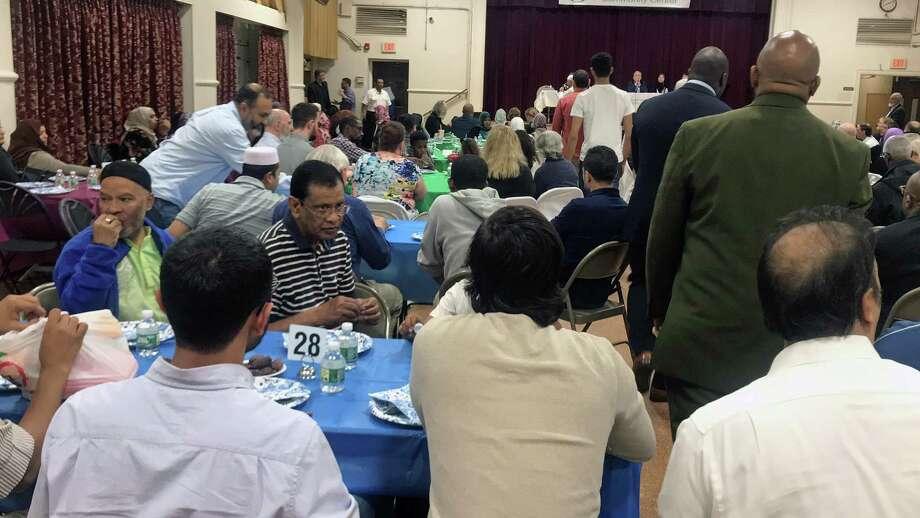 Local residents break the fast during Ramanda at the Bridgeport Islamic Community Center in Bridgeport, Conn., on May 21, 2019. Photo: Hearst Connecticut Media / Tara O'Neill