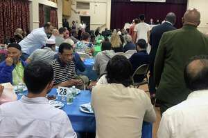 Local residents break the fast during Ramanda at the Bridgeport Islamic Community Center in Bridgeport, Conn., on May 21, 2019.