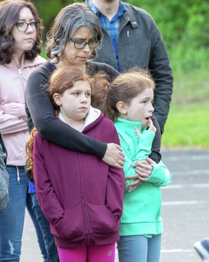 Yvette Packard hugs her children Lily and Harmony, during a service at the Redeemer Church to pray for all those involved in the circumstances surrounding the suicide of Caitlin Melville and the murder of her 5-year-old daughter. The service was held on Tuesday, May 21, 2019 at the Guilderland church on Schoolhouse Road (Jim Franco/Special to the Times Union.)