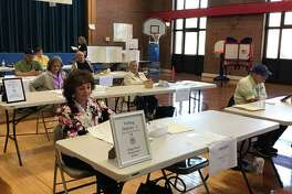 Residents cast their ballots in the gymnasium at 7 Linsley St. during North Haven's budget referendum on Tuesday.