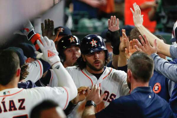 Houston Astros outfielder Jake Marisnick high fives his teammates in the dugout after scoring on the Chicago White Sox on a 2-run double by Michael Brantley during the fifth inning of a major league baseball game at Minute Maid Park on Tuesday, May 21, 2019, in Houston.