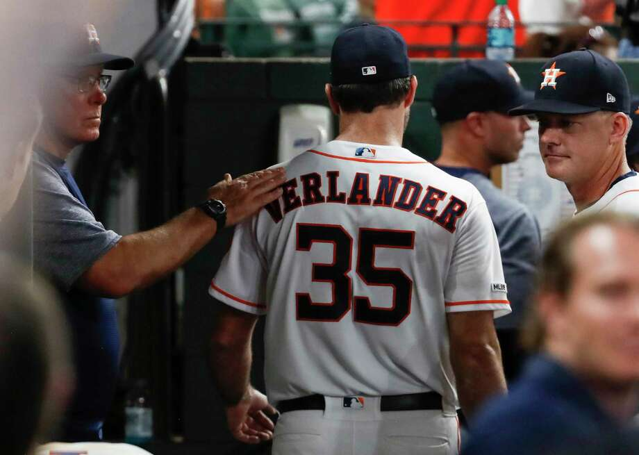 Houston Astros starting pitcher Justin Verlander is pat on the back by pitching coach Brent Strom as he walks through the dugout following the top of the seventh inning of a major league baseball game at Minute Maid Park on Tuesday, May 21, 2019, in Houston. Verlander lost a no-hitter on a solo home run by Chicago White Sox first baseman Jose Abreu. Photo: Brett Coomer, Staff Photographer / © 2019 Houston Chronicle