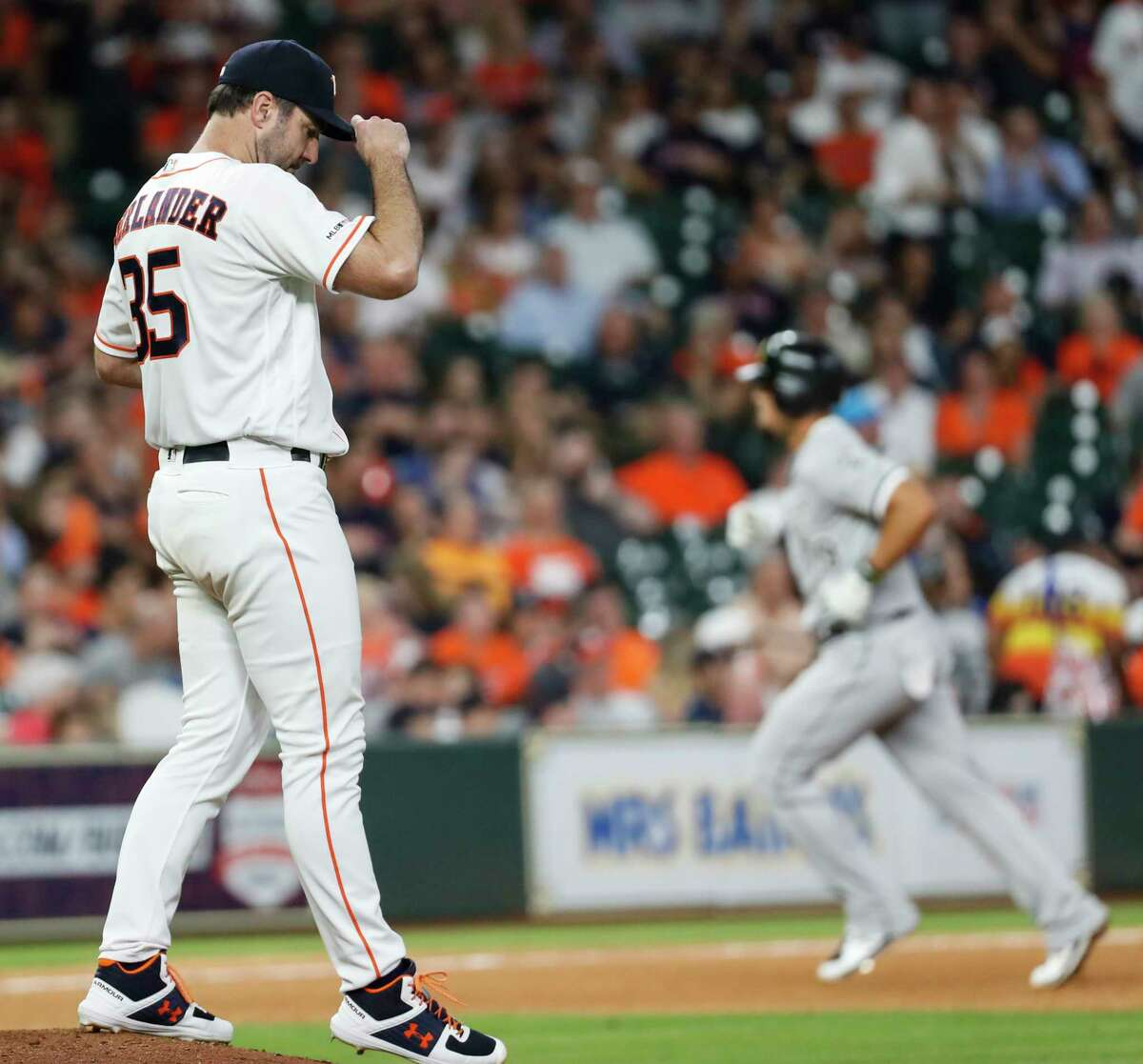 Houston Astros starting pitcher Justin Verlander walks back to the mound after giving up a solo home run to Chicago White Sox first baseman Jose Abreu, breaking up his no-hitter, during the seventh inning of a major league baseball game at Minute Maid Park on Tuesday, May 21, 2019, in Houston.