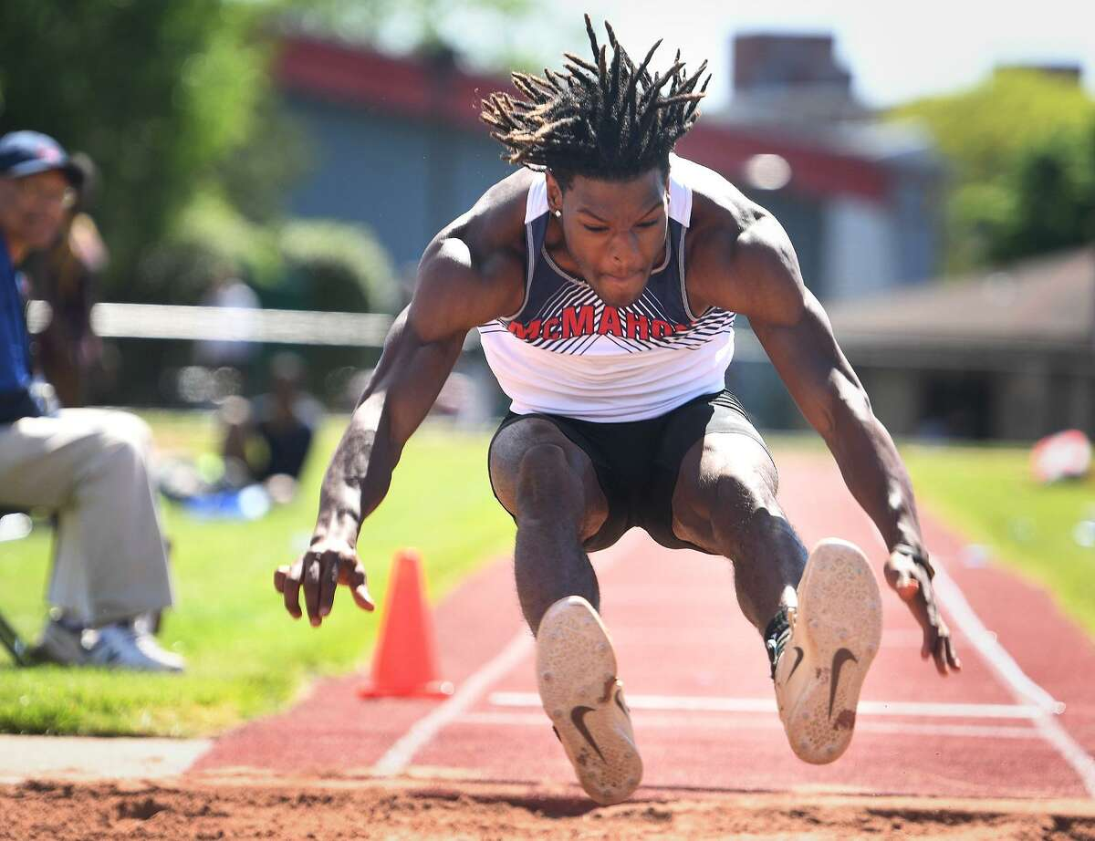 McMahons Justin Forde wins the long jump with a distance of 24 feet, 61/4 inches at the FCIAC Outdoor Track and Field Championships at Southern Connecticut State University in New Haven on Tuesday.