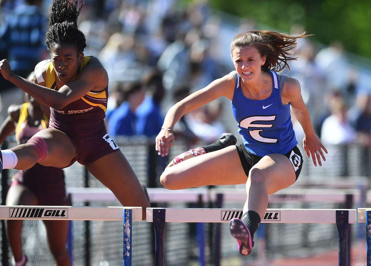 Fairfield Ludlowe's Tess Stapleton, right, wins a race over St. Joseph's Kayla Clark in the finals of the 100-meter hurdles at the FCIAC Outdoor Track and Field Championship on Tuesday at Southern Connecticut State University in New Haven.