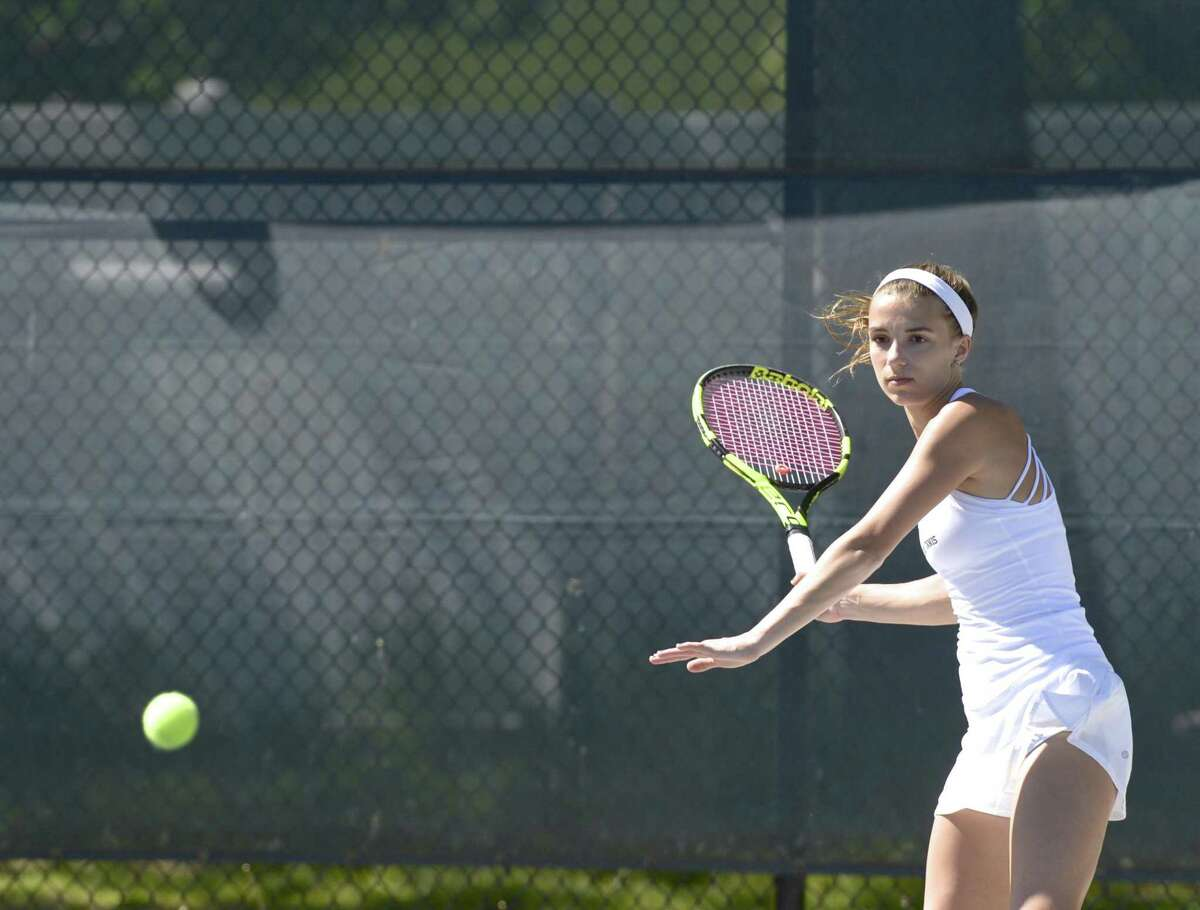 Wilton's number one Izzy Koziol warms up before her FCIAC girls tennis finals match with Staples Allyssa Dimaio. Tuesday, May 21, 2019, at Wilton High School, Wilton, Conn.