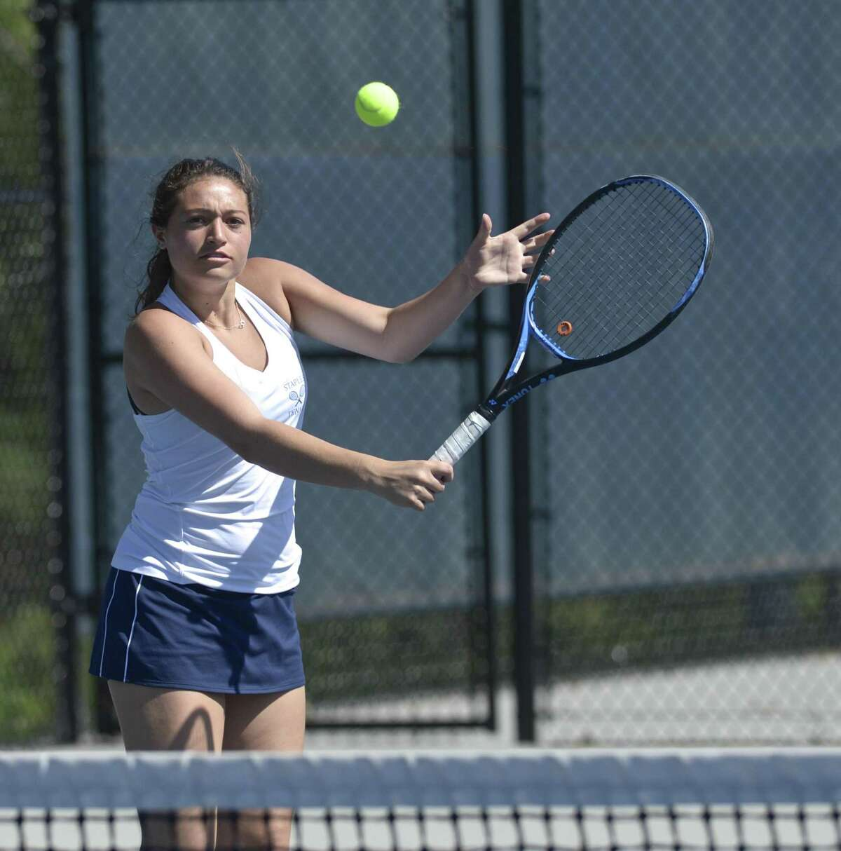 Staples' No. 1 Allyssa Dimaio warms up before her FCIAC girls tennis finals match with Wilton's Izzy Koziol. Tuesday, May 21, 2019, at Wilton High School, Wilton, Conn.