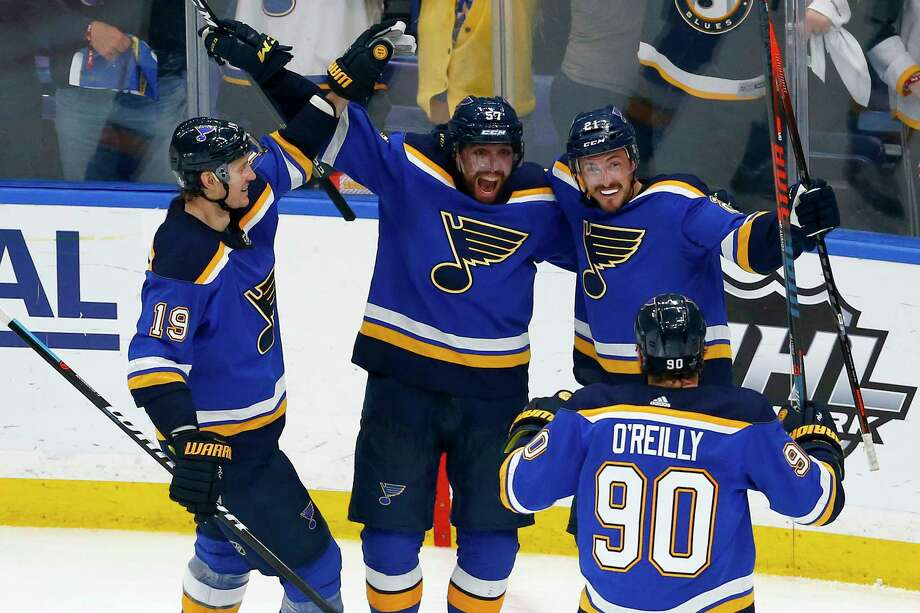 ST LOUIS, MISSOURI - MAY 21: Tyler Bozak #21 of the St. Louis Blues celebrates with teammates after scoring a goal on Martin Jones #31 of the San Jose Sharks during the third period in Game Six of the Western Conference Finals during the 2019 NHL Stanley Cup Playoffs at Enterprise Center on May 21, 2019 in St Louis, Missouri. (Photo by Dilip Vishwanat/Getty Images) Photo: Dilip Vishwanat / 2019 Getty Images