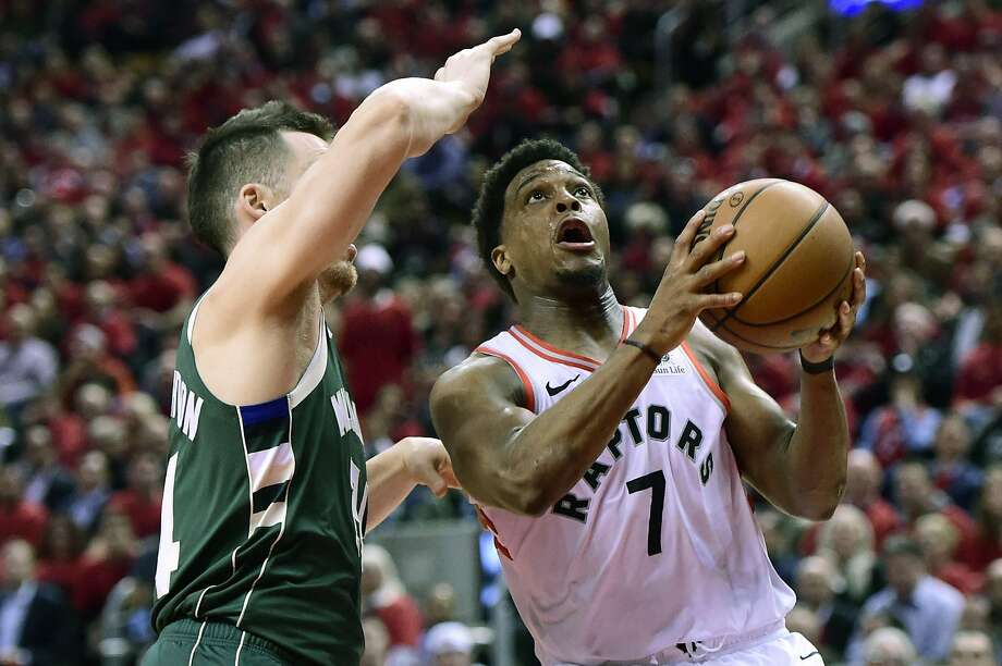 Toronto guard Kyle Lowry drives around Milwaukee guard Pat Connaughton. Photo: Frank Gunn / Associated Press