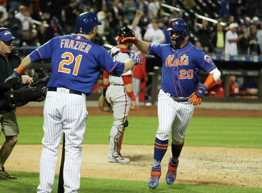 NEW YORK, NEW YORK - MAY 21:  Pete Alonso #20 of the New York Mets celebrates his eighth inning solo home run with Todd Frazier #21 against the Washington Nationals during their game at Citi Field on May 21, 2019 in New York City. (Photo by Al Bello/Getty Images) Photo: Al Bello / 2019 Getty Images