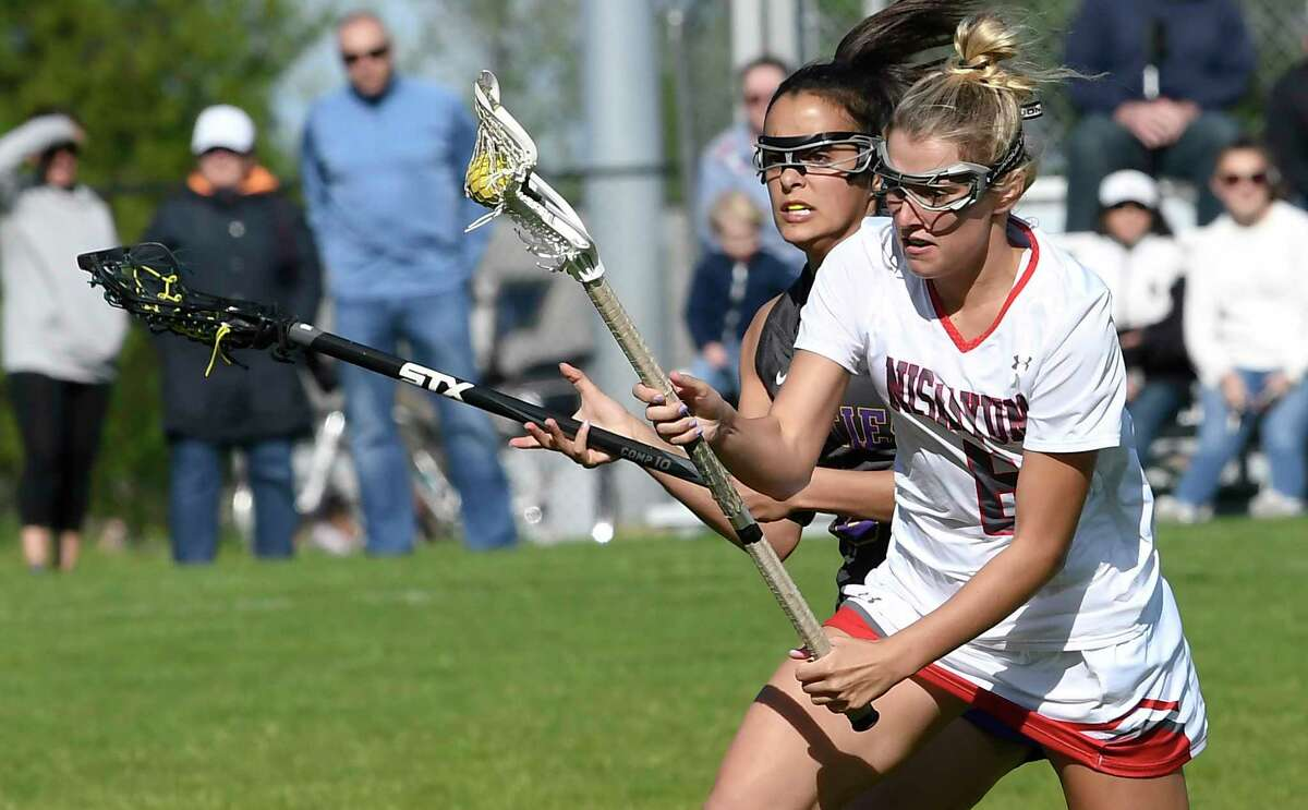 Niskayuna's Annabelle Conover (6) moves the ball in front of Ballston Spa's Sarah Rule (8) during a Section II Class B semifinal girls' lacrosse game Tuesday May 21, 2019, in Niskayuna, N.Y. (Hans Pennink / Special to the Times Union)