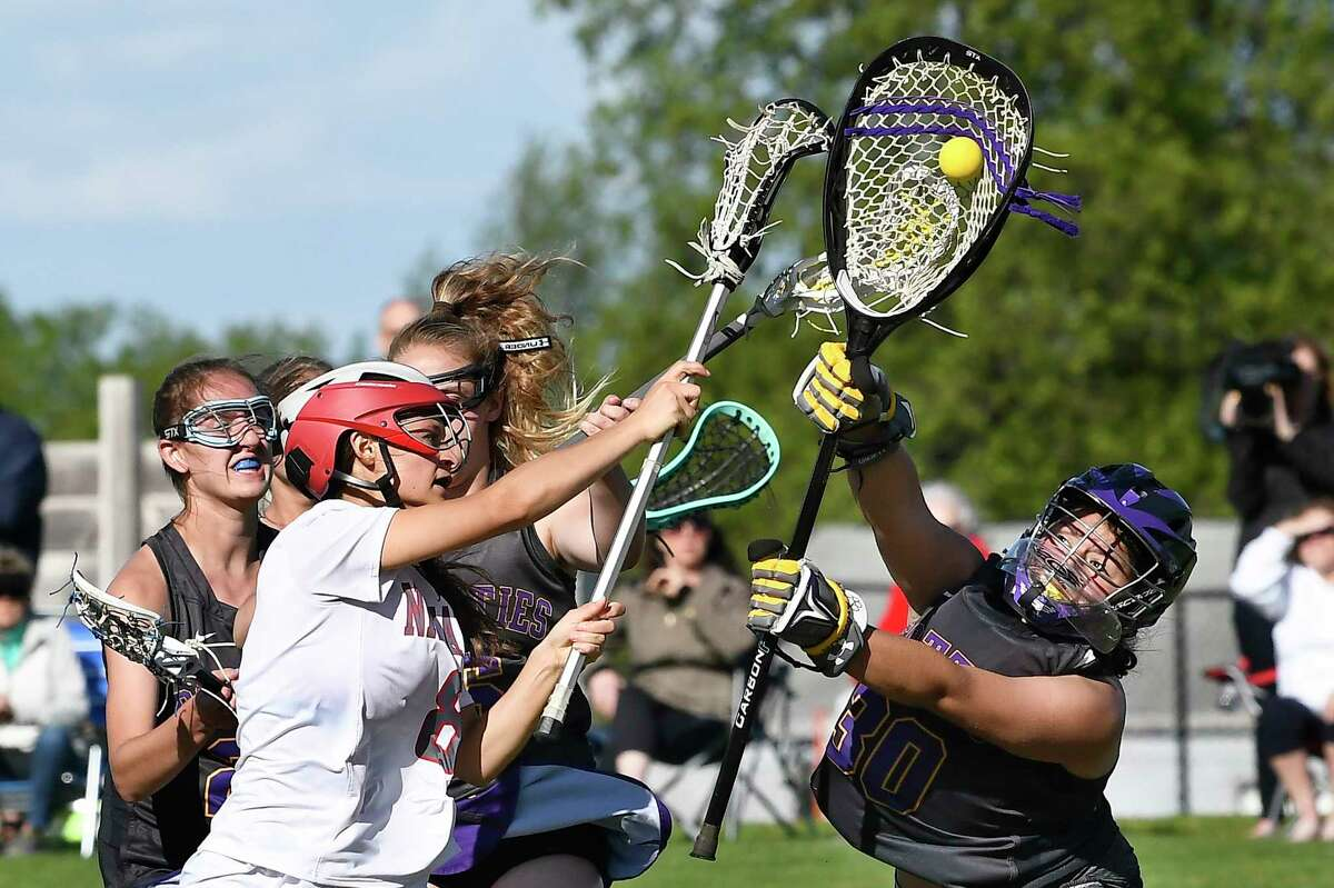 Niskayuna's CJ Harvey (8) shot is blocked by Ballston Spa goaltender Gia Burdick (30) during a Section II Class B semifinal girls' lacrosse game Tuesday May 21, 2019, in Niskayuna, N.Y. (Hans Pennink / Special to the Times Union)