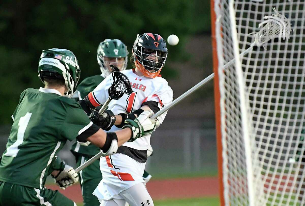 Bethlehem's Liam Ferris, center, scores against Shenendehowa during a Section II Class A semifinal boys' lacrosse game Tuesday May 21, 2019, in Delmar, N.Y. (Hans Pennink / Special to the Times Union)