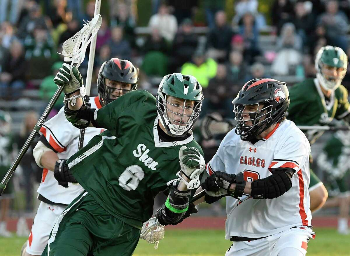 Shenendehowa's Joseph Knudsen (6) moves the ball against Bethlehem's Connor Carroll (9) during a Section II Class A semifinal boys' lacrosse game Tuesday May 21, 2019, in Delmar, N.Y. (Hans Pennink / Special to the Times Union)