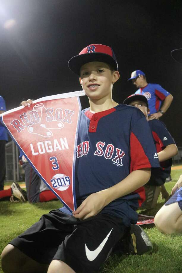 Red Sox player Logan Pickering displays the flag with his name on it during on-the-field ceremonies Tuesday night, a souvenir from this spring's campaign. Photo: Robert Avery