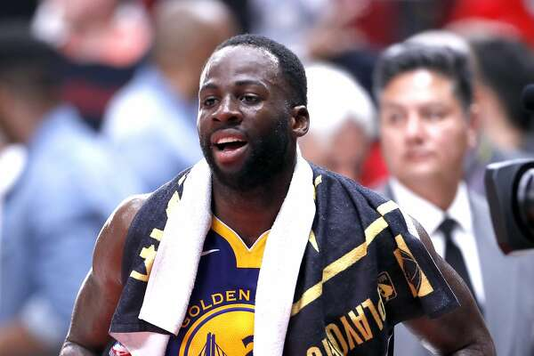 Golden State Warriors' Draymond Green walks over to greet a crowd member after Warriors' 110-99 win over Portland Trail Blazers in Game 3 of the NBA Western Conference Finals at Moda Center in Portland, Oregon on Saturday, May 18, 2019.