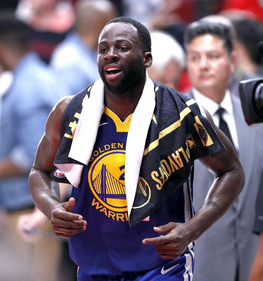 Golden State Warriors' Draymond Green walks over to greet a crowd member after Warriors' 110-99 win over Portland Trail Blazers in Game 3 of the NBA Western Conference Finals at Moda Center in Portland, Oregon on Saturday, May 18, 2019. Photo: Scott Strazzante, The Chronicle